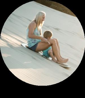 woman and child sandboarding